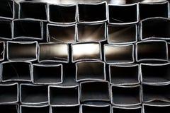 抽象管道被堆积的钢 库存图片