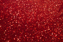 抽象红色Bokeh为圣诞节背景,闪烁lig盘旋 免版税图库摄影