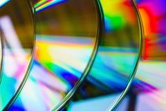 抽象背景带CD的圆盘defocused光 库存图片