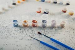 抽象背景构成守护程序黑暗的数字式幻想妖怪绘画正方形主题拖钓 套画架、油漆和刷子 库存图片