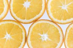 抽象背景柑橘关闭果子橙色摄影切工作室 特写镜头 背景画笔关闭查出摄影白色的工作室牙 免版税库存照片