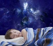 抽象背景的睡觉的女孩 免版税库存照片