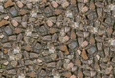 抽象背景石头小光滑的多色参差不齐的自然本底 免版税库存图片
