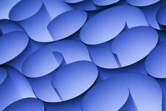 抽象背景蓝色卷曲的纸张 库存图片