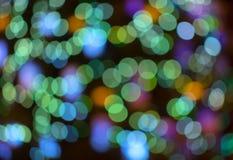 抽象背景蓝色bokeh 夜城市的色的光 免版税图库摄影