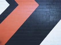 抽象背景,在红色橙色白色的砖墙 免版税库存图片