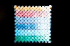 抽象背景,彩虹摆正了在黑色的圈子 库存图片