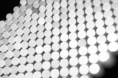 抽象背景,白色在黑bokeh 免版税库存照片
