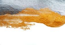 抽象背景绘与金和银油漆刷子  免版税库存图片