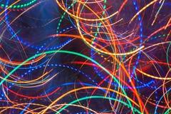 抽象背景 明亮的发光的多彩多姿的波浪和圆的固体和破折线 免版税库存照片