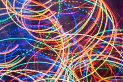 抽象背景 明亮的发光的多彩多姿的螺旋扭转的线 图库摄影