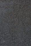 抽象花岗岩自然被仿造的固定的石纹理 黑暗的墙壁 免版税库存照片