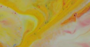 抽象荧光的背景 在多彩多姿的液体的墨水 免版税库存照片