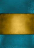 抽象葡萄酒蓝色背景和金子镶边了中心 免版税图库摄影
