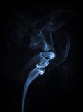 抽象蓝色烟流动的垂直的背景 免版税库存照片