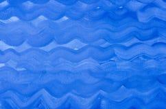 抽象蓝色被绘的水彩波动图式 免版税库存照片