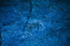 抽象藏青色纹理和背景设计的 背景蓝色金模式葡萄酒 用石头做的概略的蓝色纹理 免版税库存图片