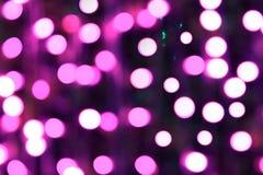 抽象装饰欢乐圣诞快乐的背景紫色和蓝色bokeh 库存图片