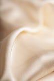抽象软的金黄织品背景 免版税库存图片
