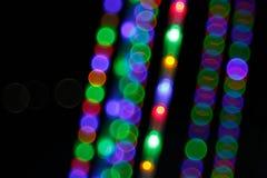 抽象轻的Bokeh背景 defocus光的迷离图片在晚上 免版税库存照片