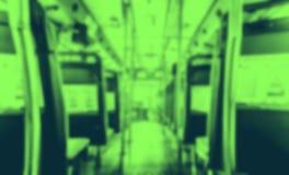 抽象迷离背景,在有位子和peo的公开公共汽车里面 库存照片