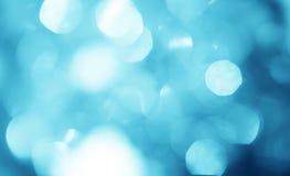 抽象迷离天蓝色bokeh照明设备背景 库存照片