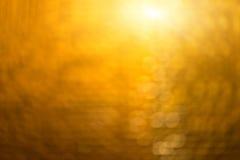 抽象迷离金黄bokeh照明设备 库存照片