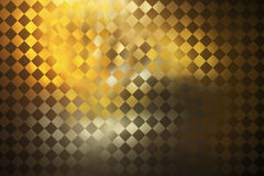抽象金黄方格的难看的东西背景 库存图片