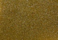 抽象金黄闪烁纹理 免版税库存图片