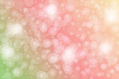 抽象闪光星、光、闪闪发光和泡影在绿色,桃红色和橙色背景 免版税库存图片