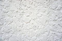 抽象难看的东西背景-白色被察觉的墙壁 库存照片