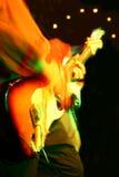 抽象音乐会吉他弹奏者 库存照片