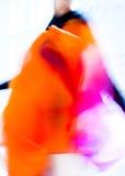 抽象颜色时尚桔子的时尚女孩 免版税库存照片