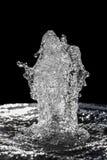 水抽象飞溅在黑背景的 免版税库存照片