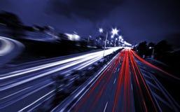 抽象高速公路在夜之前 库存图片