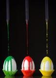 抽象鸡蛋和黑铅笔 免版税库存图片