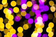 抽象黄色紫色点燃bokeh背景 库存照片