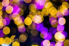 抽象黄色紫色点燃bokeh背景 图库摄影