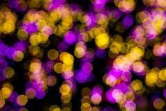 抽象黄色紫色点燃bokeh背景 库存图片