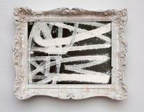 抽象派在葡萄酒古董白色框架的表现主义帆布 库存图片