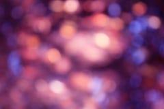 抽象紫罗兰色bokeh光背景 免版税库存照片