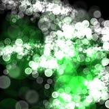抽象绿色白色bokeh黑暗背景 库存照片