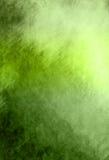 抽象绿色背景或与明亮的中心聚光灯和黑色装饰图案的圣诞节背景毗邻与葡萄酒grung的框架 免版税库存图片