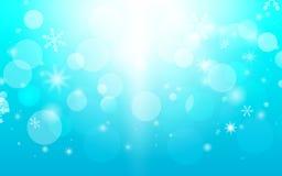 抽象bokeh和雪花在蓝色背景中 快活圣诞节的概念 图库摄影