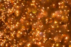 抽象bokeh背景 圣诞节发光的棕色背景 库存图片