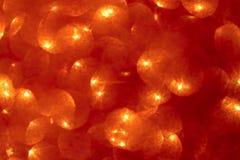 抽象bokeh背景 圣诞节发光的红色泡影背景 库存例证