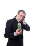 担心的生意人电话 库存图片