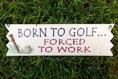 负担打高尔夫球 库存图片