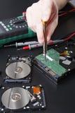 拆卸的磁盘驱动器紧密  库存图片
