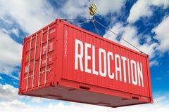 拆迁-红色垂悬的货箱 库存图片